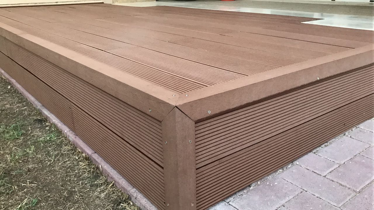 Supply and installation of wpc decking flower bed gates for Plastic composite decking